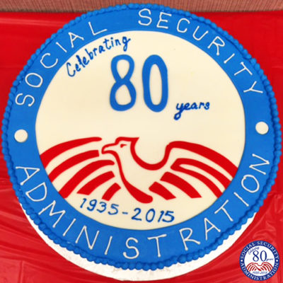 A cake that has the 80th Social Security seal frosted on it