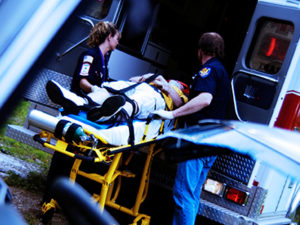 A person being taken to the hospital in an ambulance.