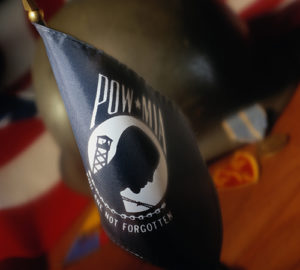 A POW/MIA flag on a desk