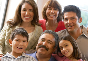 A large Hispanic family smiling