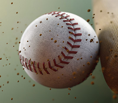 A baseball being hit by a bat