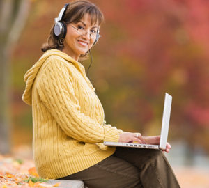 happy woman outside  with lap top