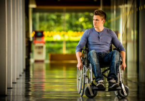photograph of a man in a wheelchair