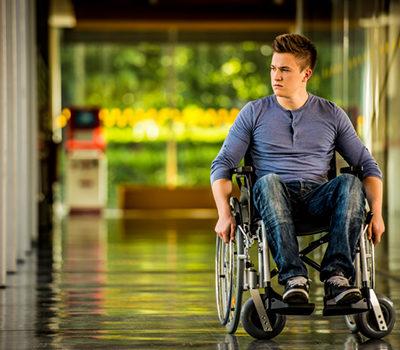photograph of a man in a wheelchair