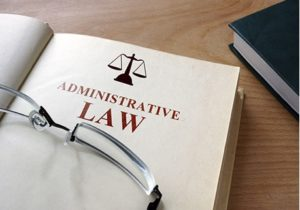 a picture of glasses on an administrative law legal book