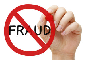 Hand drawing Fraud prohibition sign concept with red marker on transparent wipe board.