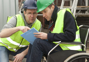Man in wheelchair after acident at work. Worker suffering from an illness.