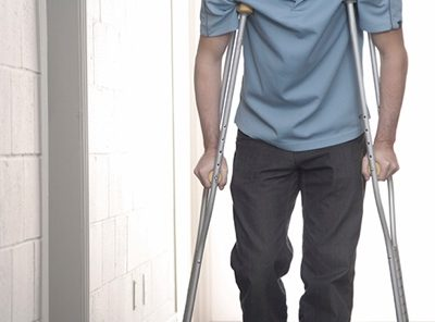 Picture of a man on crutches