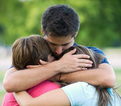 A family hugging after a prisoner's release