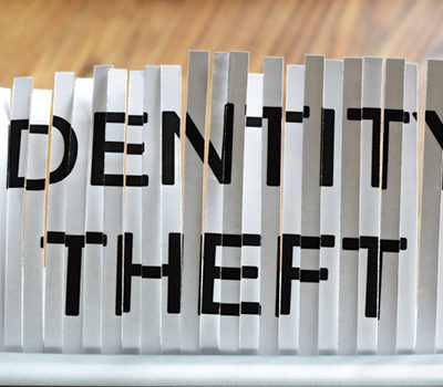"A shredded paper through a scanner saying ""IDENTITY THEFT"""