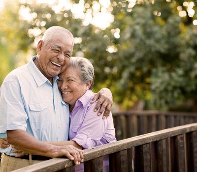 A husband and wife hugging
