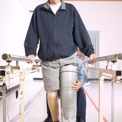 A man learning to walk with a cast