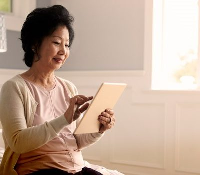 A woman on a tablet device