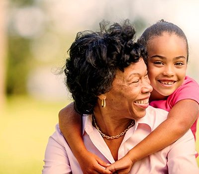 A little girl hugging older woman
