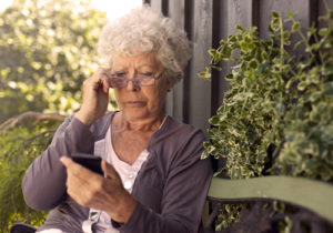 Woman Looking At Cell Phone The Acting Inspector General Of Social Security  ...