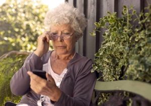 elderly woman on cell phone