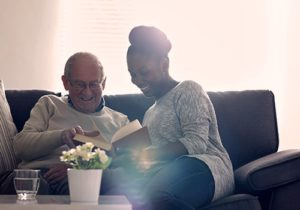 man & woman reading on the couch