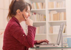 woman sitting on a laptop
