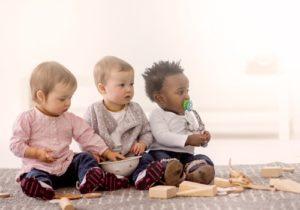 3 babies sitting together