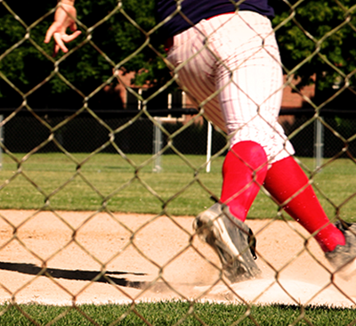 A baseball player running around first base