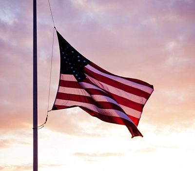 An American flag being flown at half-mast