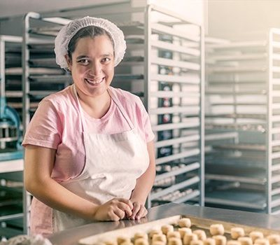 A woman baking at her place of employment
