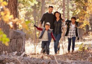 family walking outside in the woods