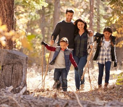 A family hiking in the woods