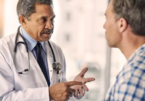 man and doctor chatting