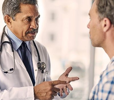 A doctor having a discussion with a man