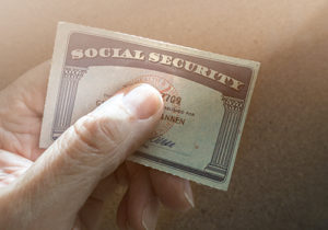 hand holding social security card
