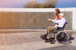 man in wheel chair and woman