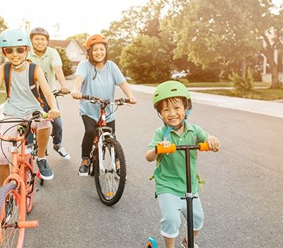 A family riding bikes in a neighborhood