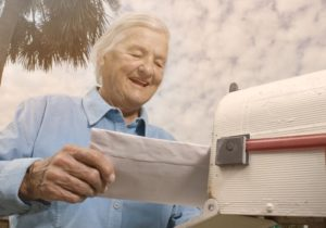 man mailing a letter