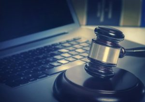laptop and a judge gavel