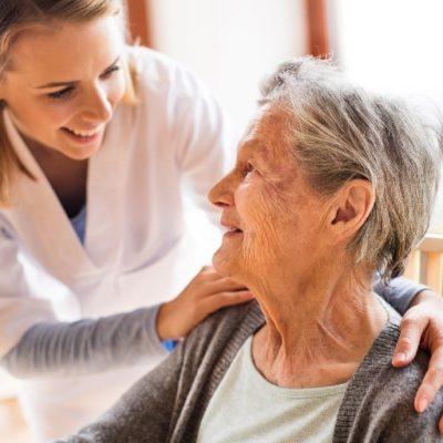 A nurse talking to an elderly woman