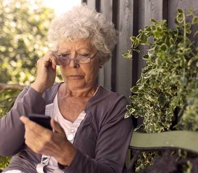 An elderly woman on cell phone