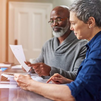 An older couple reviewing a social security benefit statement