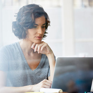 woman reviewing information on laptop