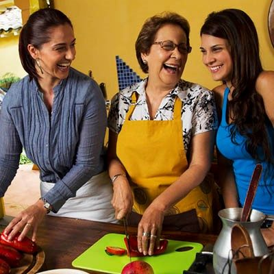 mother and daughters laughing together