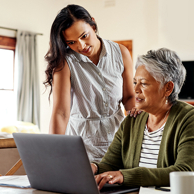 young woman and older woman reviewing information on a laptop